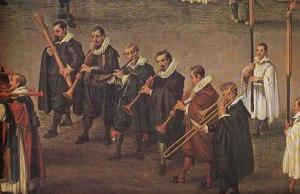 Detalle de Fiesta del Ommeganck [1616], de Denys van Alsloot. El fagot es el primer instrumento por la izquierda.